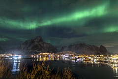 Northern NIghts (Joost10000) Tags: reine lofoten norway lapland europe arctic beauty mysterious magnetic aurora borealis auroraborealis view town mountains night atalntic harbour winter cold chill epic drama green stars canon canon5d eos norge norwegen landschaft landscape outdoors sky mountain sea water atlantic
