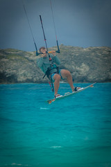 Andrew jumping high while kiting near Compass Cay.