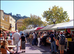 Street Market,  Nice, France. (Country Girl 76) Tags: nice france street market people fruit flowers stalls tables chairs outside cafe buildings architecture trees summer sunshine