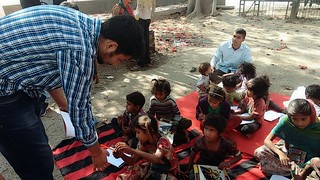 Volunteers teaching flyover kids at IIT Flyover near MTNL Exchange (Huaz Khas).