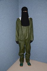 Rainwear (Warm Clothes Fetish) Tags: slave hijab burka chadpr maid waitress coat fur fleece hot warm sweat torture girl boots rubber rainwear