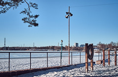 Not quite beach weather yet (Jaroneko) Tags: my12018 helsinki finland hietaniemi beach winter snow ice sea powerlines
