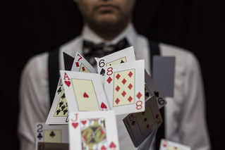 Man with flying playing cards