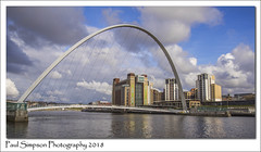 Gateshead Millennium Bridge (Paul Simpson Photography) Tags: tyneside rivertyne water bluesky urbanphotography urban bridge swingbridge residentialtowerblocks towers highrise hirise clouds paulsimpsonphotography imagesof imageof photoof photosof april2018 england viewsof crossingabridge city skyline tyneandwear gatesheadmillenniumbridge sky tower buildings river building architecture