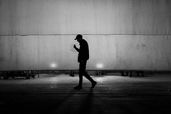 To the beat (EyeOfTheLika) Tags: ifttt 500px black white monochrome bw faceless darkness blackwhite silhouette shadow cap hat film screen behind scenes filming video lika street photography walking add new keyword