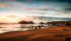 Bandon Beach (Manuela Durson) Tags: bandon beach facerock face rock ocean sunset sand sunsetoverwater sunsetoverocean water warm oregon oregoncoast pacific pacificocean northwest