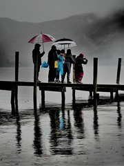 "Welcome to British Summertime (Say ""Wasabi"") Tags: determination dedication weather british britishweather m43 olympus storms rain jetty umbrella wind colours"