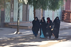 Walking to Market (meg21210) Tags: women streetscene desert sahara morocco street town village veils blackrobes fourwomen moroccan marketday