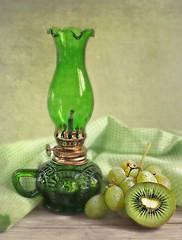 My green oil lamp (Through Serena's Lens) Tags: lifeisarainbow green oillamp grape kiwi fruit ginghamfabric stilllife closeup texture tabletop tistheseason pastfeaturedwinner