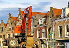 Demolition (Mattijsje) Tags: new old antique houses trapgevels 16de eeuws centuries oudewater holland nederland netherlands demolition afbraak huizen graafmachine digging machine caterpillar amsterdam