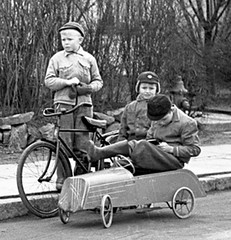 It is getting too small (theirhistory) Tags: children kids boys bile bicycle car hat jacket coat wellies road path rubberboots boxinggloves mittens