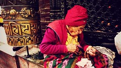 granny who help doing prayers at Boudhanath Temple, Kathmandu, one of the largest spherical architectures in Nepal and a UNESCO world heritage surrounded by over 50 Tibetan Monasteries. (qqazwws18) Tags: boudhanathstupa boudhanathtemple sonya6000 sony religion religious travel kathmandu nepali nepal