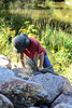 Exploring on the Rocks (Vegan Butterfly) Tags: outside outdoor whitemud ravine nature reserve edmonton alberta kid child rocks hat person candid
