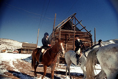 1a-299 (ndpa / s. lundeen, archivist) Tags: nick dewolf nickdewolf photographbynickdewolf 1977 1970s color 35mm film 1a reel1a aspen colorado fall autumn snow november rockymountains foxhunt hunt woodycreek woodycreekhounds roaringforkvalley equestrian horse horseback rider equestrians horses riders hat hats jodhpurs boots woman women building buildings logbuilding vehicles powerlines utilitypoles roaringforkhunt roaringforkhounds