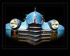 Olds #1 (madmtbmax) Tags: american americancar usa uscar oldtimer oldsmobile blue nose grill chrome headlight headlights emblem 1940s background framed frames