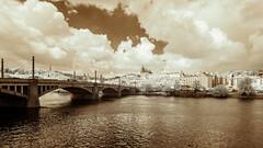 Prague Panorama (Adventures in Infrared) (Torsten Reimer) Tags: olympusepl5 fluss czechrepublic europa himmel tschechien czechia clouds infrared river wasser water prag sky bridge prague infrarot wolken europe cz