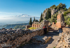 View of foggy Mount Etna, from via Teatro Greco, in Taormina, Sicilia, Italy. (Apostolis Giontzis) Tags: heritage art culture architecture landscape roman archaeology ancienttheatre ruins magnagraecia magnagrecia ancient ancientgreece scenic hill rock stone attraction catania december destination etna europe holidays island italia italian italy mediterranean mountain mountainpeak nature picturesque sea sicilia sicilian sicily snow sunny taormina taurmina tourism tourist travel travelling trees vacation view winter wintersun nikon nikond800e d800e