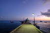 Pier at sunset in Barbados (` Toshio ') Tags: toshio barbados oistins pier sunset clouds boat caribbean caribbeansea ocean water lamppost fujixt2 xt2 fisherman man people