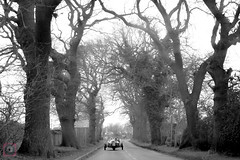 Sports car - Sunday drive (picsbyCaroline) Tags: car sports racing country landscape road driving old vintage black white driver woods trees sunday village scotland spring drive motor