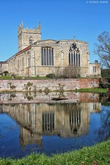 St. Mary's church, Barton upon Humber (SteveH1972) Tags: blue sky spring 2018 canon700d 700d canonef28135mmf35 28135 canon bartonuponhumber barton northlincolnshire town england northernengland britain europe stmaryschurch church architecture building old water pond outside outdoor outdoors lincs reflection