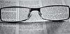 focused on a good book (kevin towler) Tags: book glasses text stilllife blackandwhite black white
