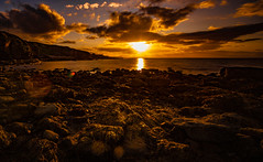 Collach sunset (Tom McPherson) Tags: tommcphersonraw cummingston seascape scotland moray seaweed shore cliffs burghead view water sky red orange coast night evening nikon 16mm 1635mm nikkor wide angle d750 long exposure