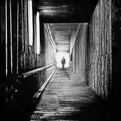 magical mystery tour (heinzkren) Tags: schwarzweis blackandwhite bw sw panasonic lumix mystery fantasy vision abstract gang ausgang exit beton concrete architektur architecture lines geometry street streetphotography italy südtirol karersee tunnel silhouette mann man composing magic monochrome square