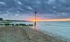Avon Beach Sunrise (nicklucas2) Tags: mudeford seascape beach beachhut lowtide pebble sand sea solent seaside groyne cloud