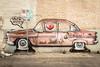 Parking Violation (DarrenCowley) Tags: urban streetphotography streetart brickwork vehicle car wall graffiti austin texas 6thstreet mural