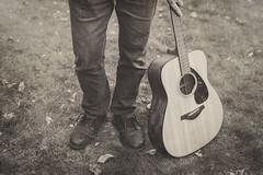 While my guitar gently weeps (charhedman) Tags: whilemyguitargentlyweeps tompetty prince jefflynne stevewinwood dhaniharrison guitar myhusbandkindlyassistingasapropinmyphotographyagain backyard monochromatic blackandwhite