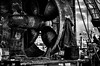 L'hélice et le manteau / The propeller and the coat (vedebe) Tags: bateaux bateau pêche humain human homme people guilvinec leguilvinec bretagne france chantier chantiernaval noiretblanc netb nb bw monochrome marine travail rue street ville city urbain urban port ports mer océan