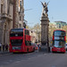 Two red buses and the Griffin by Charles Bell Birch