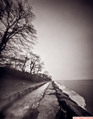 The skating trail. (DelioTO) Tags: 4x5 beaches blackwhite canada d23 f175 fomapan100 lake landscape ontario pinhole rain trails winter