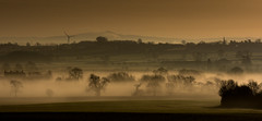 Mist in the Valley (Peter Quinn1) Tags: measham leicestershire mist mistymorning rivermease layers spring windturbine sepia steeple village valley