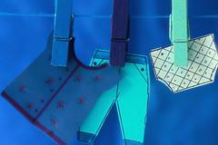 Laundry Day (Chandana Witharanage) Tags: srilanka southasia macromondays theblues smallclothpegs papercraft shadesofblues macrophotography macro canoneos7d ef100mmf28lmacroisusm chandanawitharanagephotography flickrfriday100percent 7dwf wednesdaymacroorcloseup