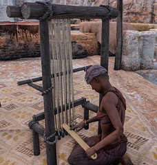 A weaver prepares a loom  in ancient Alexandria in Assassin's Creed Origins Discovery Tour (mharrsch) Tags: ancient alexandria egypt ptolemaicperiod assassinscreedorigins discoverytour mharrsch leather tanning hide loom weaving fabric textile