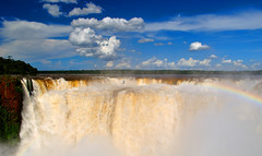 Iguazu Falls (makingacross) Tags: nikon d3000 iguazu falls iguacu argentina waterfall water spray sky blue clouds rainbow