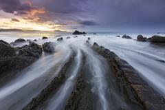 Tales of dragon (explore) (Rafael Díez) Tags: españa paisvasco vizcaya barrika agua mar rocas atardecer paisaje sunset sol sun nubes rafaeldíez filtro