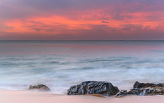 Luminescent Pink Sunrise Seascape (Merrillie) Tags: daybreak sunrise cloudy australia waterscape nsw centralcoast clouds sea newsouthwales rocks earlymorning morning water landscape ocean nature sky pink coastal seascape outdoors killcarebeach dawn coast killcare waves