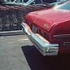 Red Nova, car and carts (ADMurr) Tags: la eastside costco parking lot red nova chevy chrome direct sun rolleiflex 35 e kodak ektar cbc598
