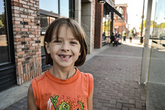 Rose on the Street (Vegan Butterfly) Tags: outside outdoor city urban person child kid cute adorable vegan smile smiling happy street portrait