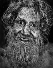 Street Portrait - I moaned because I had no shoes, until I met a man who had no feet. (Louay Henry.) Tags: nikon nikond610 d610 blackandwhite blackwhite monochrome streetlife streetphotography india oldman man poor poorman face closeup urban people humanbeing mustache beard eyes candid streetcandid streetportrait streetportraiture portraiture portrait strangers character tamron lonely lifeishard homeless tamron70200mmvc tamronsp70200mmf28vcusd naturallight outdoor