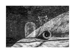 Deptford Wheel Arch © (wpnewington) Tags: wall brick arches railway deptford discarded wheel monochrome bw sunlight light shadow