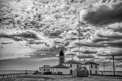 Beavertail Lighthouse in Jamestown, Rhode Island (WilliamND4) Tags: fencefriday hff blackandwhite lighthouse clouds nikon d810 coast ocean cloudy rhodeisland newengland