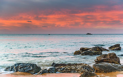 Sunrise Seascape with Rocks and Boats (Merrillie) Tags: daybreak sunrise cloudy australia clouds nsw centralcoast boats sea newsouthwales rocks earlymorning morning water landscape ocean nature sky waterscape coastal seascape outdoors killcarebeach dawn coast killcare waves