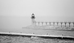 Light in the Fog (mswan777) Tags: fog mist pier lighthouse weather shore coast seascape lake michigan nature outdoor wave water light ice winter snow ansel monochrome black white nikon d5100 sigma 70300mm