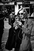 Moon (Kieron Ellis) Tags: woman street blackandwhite blackwhite monochrome glasses sunglasses phone earrings