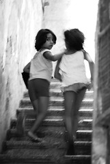What are you looking at ? (MayaAlameddine) Tags: kids girl gentle image light love portrait portraiture photography pride look blackwhite beauty noirblanc naturallight hair storytelling strength stairs streetphotography silence hope words up moment innocence child childhood