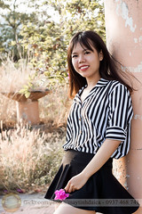 Standing in garden afternoon (Hosting and Web Development) Tags: young hay grass one person sunlight sunshine smile hair eyes vertical garden stand flower femininity female woman nikon afternoon summer casual clothing tree column colonnade shoulder happy face arm body