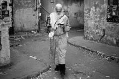 Prayerful walker (michael.mu) Tags: jerusalem meashearim purim theleicameet leica m240 50mm leicaaposummicronm50mmf2 silverefexpro bw blackandwhite monochrome judaism orthodox streetphotography